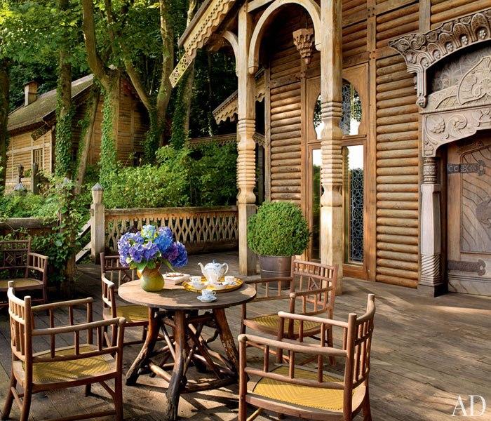 8 pierre berge la dacha normandy log house rustic home decor russian architecture  moroccan windows eastern rugs exterior terrace